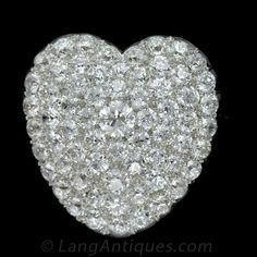 Edwardian Diamond Heart Pin  Pendant I am in love. Eleven carats of high quality European cut diamonds. It can also be worn as a pendant. I can see it on a scarlet velvet ribbon around a lucky girls swan neck.