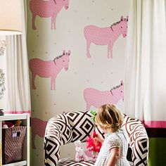 Instead of painting an accent wall, cover it with arty or playfully printed wallpaper—a nice technique for a small space.