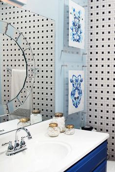 Create visual interest in a builder grade bathroom with these design tips from The Makerista. Layering a decorative mirror atop a standard frameless mirror makes for chic reflections. Her ink blot art and acrylic frame DIY are a cool addition to any space.
