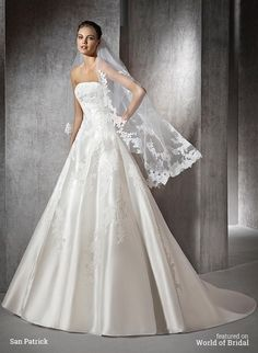 Princess wedding dress in mikado with lace and gemstone embroidery appliqués. Strapless bodice with low waist. Princess skirt.