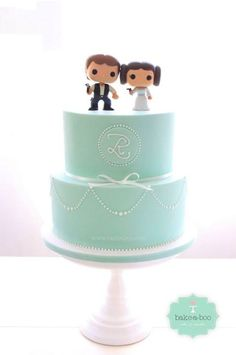 Mint green wedding cake with Star Wars toy toppers by Bake-a-boo cakes