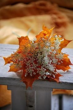baby's breath and fall leaves wedding bouquet