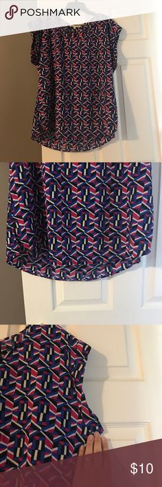 Multi-color Geometric Blouse 100% polyester blouse. Slightly longer in back than in front with cute sleeve detail. Pink, black, white and blue pattern. Daniel Rainn Tops Blouses