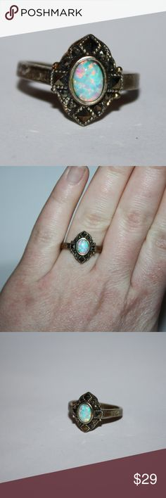 Sterling silver marcasite and opal ring Beautiful sterling silver ring with an opal center. beautiful marcasite accents on the side.  size is 9 Buy from me with confidence! I have sold over 100 items with a 5 star rating! If you have any questions, do not hesitate to ask.  Looking at a few things in my shop? Put a bundle together, comment on an item that you are ready to check out and let me send you an even better offer!  Thank you for visiting :) Free gifts with every purchase! Jewelry…