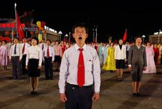 Dancers stand in formation and sing in a gala show in Pyongyang, on April 16, 2012. The performance was part of the celebration on the centenary of the birth of Kim Il Sung.