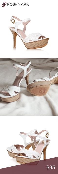 Vince Camuto | NEW White Platform Sandals NEW from Vince Camuto! These are ridiculously cute for the spring season. White strappy platform heels/sandals.  The perfect pair of shoes to match with your prom dress, wear to spring weddings, or Church on Sundays.  Very classy elegant heels. White with tan/wood finished bottom and edges, and a light salmon pink on the inside.  Tons of quality details! The heel hight is just over 4' inches.  Size 9 Vince Camuto Shoes Heels