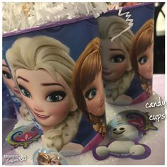 Frozen themed cups filled with candy.