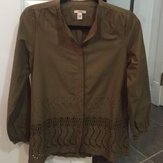 """New J.Crew cotton shirt New J.Crew olive cotton button down shirt that can be worn as a light jacket size 2. This is a J Crew outlet item so there is a red mark on the label. This has beautiful eyelet detail. 24.5"""" length and 18"""" chest J. Crew Tops Button Down Shirts"""