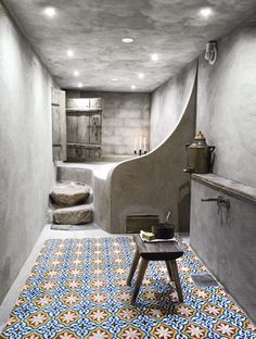 The Surprise house. The bathroom is inspired by Arabic Hammam, with generous surfaces, bare materials and beautiful Moroccan tiles on the floor.