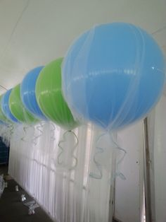 3' balloons with tulle and ribbon. Light blue and lime green wedding balloons. Wedding decorations.