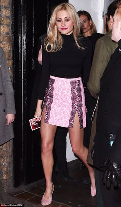 Racy: Pixie Lott showed off her long legs in a daring double-split skirt as she stepped ou...