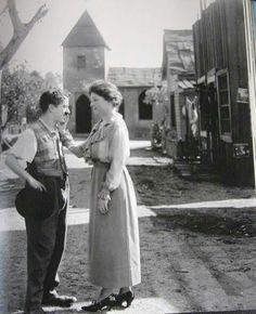 Charlie Chaplin and Helen Keller.