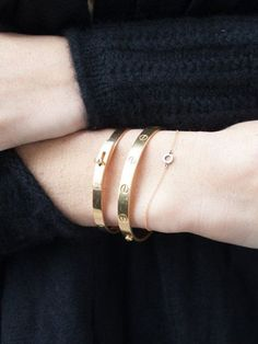 Gold Forever Love Bangle @JewelleryClub || A little love note in gold - and our tribute to Cartier's iconic Love Bracelet.  It's the perfect gift for the lady you love - and makes an elegant grown-up friendship bracelet.