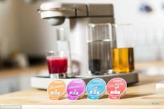 Cheers! TheBartesian appliance can make cocktails without all of the mixers - users just need alcohol and one of the brand's pre-mixed capsules | Daily Mail