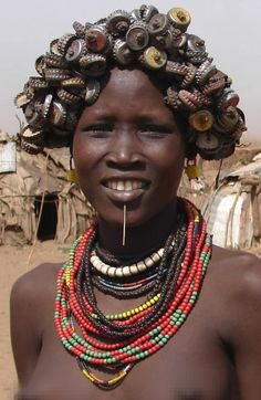 Daasanach (Merille) woman with bottle cap headdress from Omo river, Ethiopia