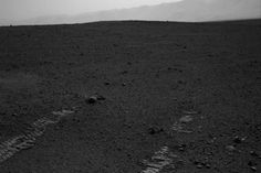 This image shows the tracks left by NASA's Curiosity rover as it completed its first test drive on Mars.