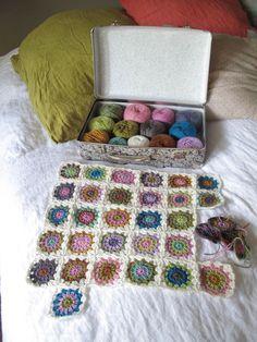 subtly-coloured granny square quilt