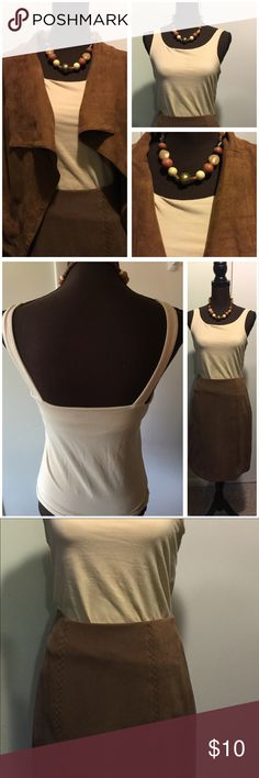 Earth beige Tank Top Size M EUC built in Bra I just love this top, it does with everything and will blend into your fall wardrobe perfectly even though it's a tank. See Pics, all other items in pictures are for sale as well (except Suede Jacket, that I'm keeping) in separate listings, see my awesome bundle sale for more details.   Check out the back I love the way it is cut, they don't sell them like this. Cotton and spandex, has a lot of stretch Dress Barn Tops Tank Tops