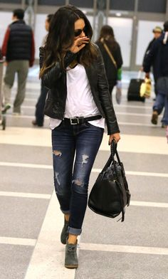 Mila Kunis. Black moto jacket + white tee + destroyed jeans