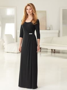 Sophiticated yet simple, this classic three-quarter sleeve dress can be worn more casually without adornment, or dressed up with any of our rhinestone pins. Silky knit lends itself to create the beautiful and soft shirring that radiates from the waistline