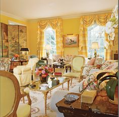 Architectural Digest:  the main living room is painted a Nancy Lancaster yellow, filled with English and French antiques and English styled upholstery.  Designed by Mario Buatta,