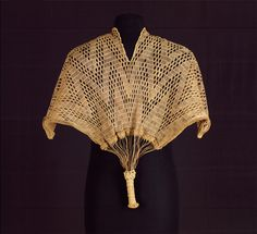 Chief's Tunic or Cape (kinzembe  or zamba kya mfumu) D.R. Congo or Angola, Kongo-related peoples  Possibly 19th century  Raffia palm fiber; openwork.