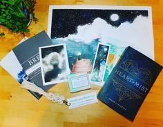SPOILER ALERT  If you have yet to picked up your Fateful Fantasy box from us (there's a few of you) you may want to avert your eyes for a sec!  We are extremely excited to finally be able to announce the featured book and box goodies for our very first box!   - The book: Heart of Mist by @helenscheuerer. We could gush about this book all day and we have in an upcoming blog post where we talk about why we chose this book.  - The prequel: Break - A Heart of Mist Prequel by @helenscheuerer. As…