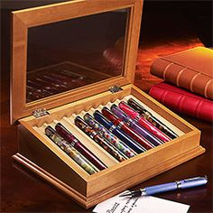 Point of View Pen Case - View your pens from a fresh angle  The Point of View Pen Case holds 10 pens at an angle, almost offering them to you when you open the glass top. Your collection is protected from dust, and the grooved cradles are lined in nonreactive suede to keep your pens pristine.