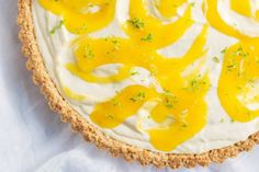 Mango Labne Cheesecake Recipe - Make the most of the mango season with this delicious tart with creamy labne, macadamia base and hint of lime - the perfect light summer treat!