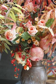 clumsy yet elegant fall floral arrangement with pomegranate and berries by natalie brookshire