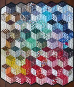 A tumbling blocks design. I like the way the colors are distributed here. Very adaptable to neutral colors.