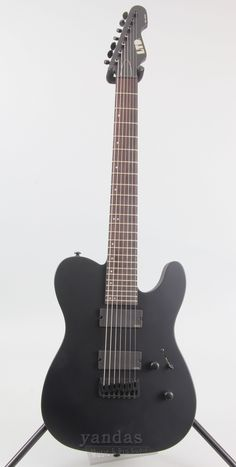 "LTD TE-417 Features - Satin Finish: Snow White & Black - 7 String Guitar - Mahogany Body - Set-Thru Neck - 3 Piece Maple Neck - Rosewood Fingerboard - 350MM Radius - 25.5"" Scale Length - Thin U Neck -"