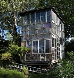 Christiania community, Copenhagen, Denmark; Check out this awesome glass house made from recycled windows.
