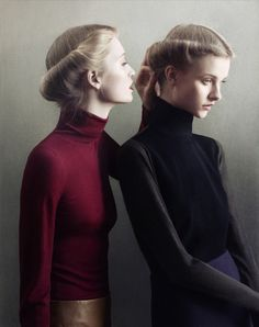 slim fitted sweaters in elegant burgundy, black and navy. We're looking to emphasize the sleek, slender line of the body.