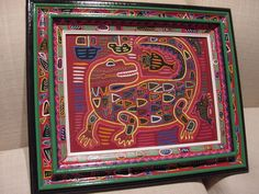 Unique Mola reverse applique created by a Kuna Indian, Panama, and framed in a hand painted signed frame. asmatcollection on ebay and Bonanza.com mailto:cheetahdmr... asmatcollection on ebay and Bonanza.com cheetahdmr@aol.com