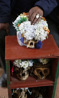 Tradition in Bolivia sees skulls in ritual to bring them good luck