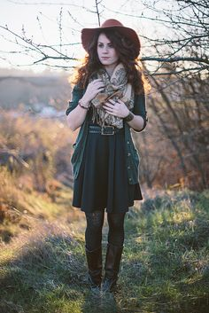 black shirtdress, scarf, green cardigan, tights, boots, hat. cute!