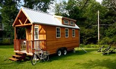 """Protohaus - Here's a great one for those of you that don't like to settle down to one place. The Protohaus is powered by solar panels and propane and is """"off the grid"""". And it travels. All that and a cute little porch to boot. 125 square feet! Love it!"""