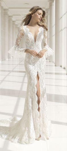 [ #ad ] Wedding Dress by Rosa Clara Bridal | This alluring yet subtle mermaid-style dress will really flatter your figure. It's made of beaded embroidered lace and features deep front and back V-necklines. The skirt has a generous slit trimmed with lace scalloping. The sheer lace sleeves are finished with beautiful lace ruffles. @rosa_clara #rosaclara #rosaclarabride #rosaclara2018 #weddingdress #bridalgown #weddingdresses #bridalgowns #bridal #bride #bridetobe #wedding #weddings