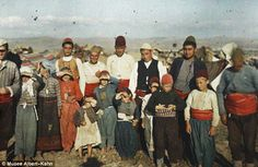 Squinting: These residents of rural Greece stare into the sun as their photo is taken