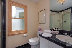 Beautiful modern bathroom with warm wood interior window we installed  Home remodeling / home improvement on Long Island - replacement window