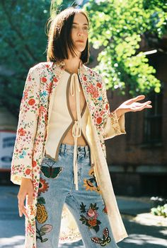 Jane Moseley in a vintage kimono, vintage tie top, and Gucci hand-embroidered jeans