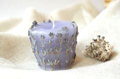 A beautiful aromatic candle with lavender flowers is a romantic gift to any holidays.  I use a paraffin (wax) without impurities, lavender