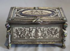 Fine antique Austro Hungarian silver and enamelled musical jewellry box. Beautifully crafted silver box with superb enamelling in polychrome. Bechanalian terms to each corner with scenes of Bachanalian romps on all sides. Fine two tune musical movement wound and operated from under the box. An outstanding and very unusual music box of exceptional quality Circa 1890. 6 inches wide.