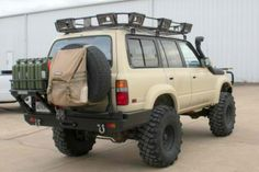 FJ80 Land Cruiser...it would seem that this truck and I share a similar obsession with MOLLE backpacks. This must be love.