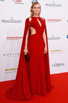 27 May Diane Kruger made a statement for the German Film Awards in a cut-out red gown with cape detail by Naeem Khan. - HarpersBAZAAR.co.uk