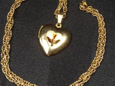 Vintage Gold HEART LOCKET Necklace w DOVE by SellitAgainVintage, $18.50  May be an option.