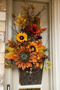This is pretty for Fall. Thanksgiving Wreaths, Autumn Wreaths, Fall Swags, Fall Flower Arrangements, Autumn Decorating, Sunflower Wreaths, Fall Flowers, Big Flowers, Fall Home Decor