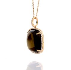 Cabochon Smoky Quartz set in Rose Gold with Diamond Halo. A gorgeous layerable pendant that pairs beautifully with brown leathers and billowy blouses! #trends #smoky quartz #diamond #pendant #necklace