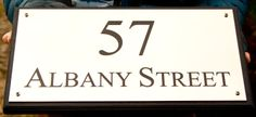 Engraved brass house address sign  on black oak backing board. Very Smart. ref - 1310.SE.041  www.sign-maker.net/engraved/brass-house-signs.htm